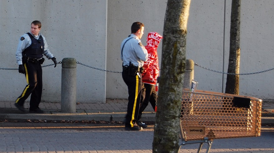 RCMP lead young male away for questioning at Newton Bus Loop in Surrey