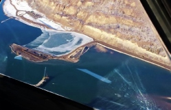 View from the air showing sediment flowing in the river