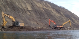 Sediment flowing alongside machines