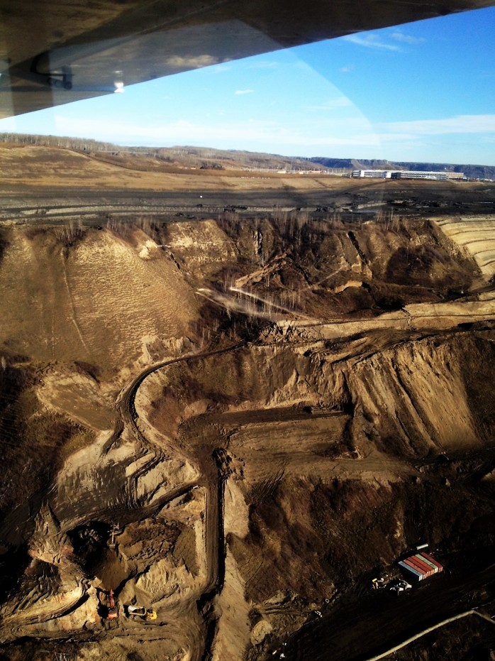 North Bank slope failure takes out entire road segment above work area.